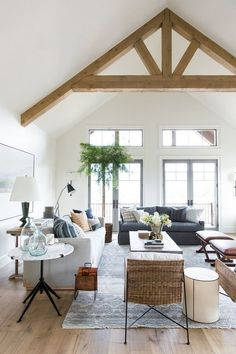 modern farmhouse living room, neutral living room decor, modern neutral living room design, neutral family room decor with coffee table decor gray sofa with modern farmhouse pillows and white walls, modern meets traditional living room Home Interior, Interior Design Living Room, Living Room Designs, Modern Living Room Design, Traditional Living Room Furniture, Scandinavian Interior, Modern Room, Interior Ideas, Interior Inspiration