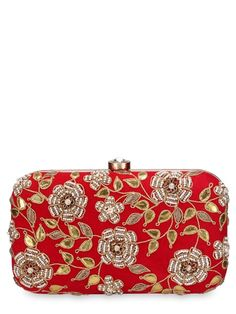 Red velvet clutch with gota, dabka and moti work in a floral vine motif on one side.  The inside of the clutch is lined with satin and has a top clasp.