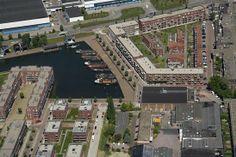 Boven aanzicht Dichterswijk. Je ziet een deel van parkhaven (links), de veilingshaven (rechts boven) en een deel van het plan gebied (rechts onder)