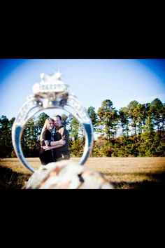 Engagement picture with ring. Super cute idea. maybe try with the ring in focus and couple kissing in background?
