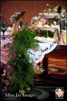 Garden Brunch Reception - garland, mixed matched china, green goblets, gold flatware, and roses, lots of roses. So romantic. Table styled and floral design by Bluegrass Chic www.bluegrasschic.com #bluegrasschicfloral