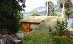 Argentinian Mountain Home by Studio Ramos Sprouts a Green Roof: The concept behind Studio Ramos design was to integrate w/ the surroundings, lifting the grasses within the home's footprint to the roof. From the approach, this rustic home appears to be just a part of a grassy meadow lined with mature pines. But peeking out is a simple modernist home wrapped in local stone & pine that overlooks pristine Lake Gutiérrez. (3)