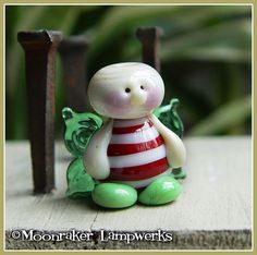 Christmas Fairy Lampwork Bead by moonrakerbeads on Etsy, $11.50