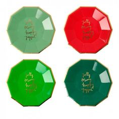 """Luxury Christmas paper plates in 4 colors with shiny gold embellished slogans spelling """"Jolly"""", """"Merry"""", """"Joyful"""", and """"Happy"""". These stylish paper plates from Meri Meri are perfect for mince pies and"""