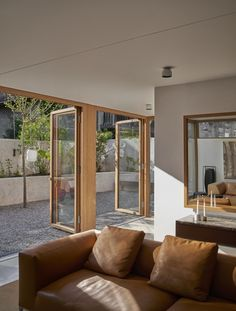 Wooden doors to the patio - Valentine Bärg Architectures Village Houses, Wooden Doors, Design Agency, Interior Architecture, Home And Family, House Design, Windows, Patio, Flooring