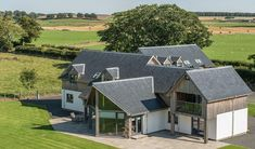 Fleming Homes are award-winning specialists in self-build homes. They design and manufacture bespoke self-build timber frame houses in Scotland for the UK. Timber Cladding, Exterior Cladding, Exterior Doors, Modern Family Rooms, Self Build Houses, Dormer Windows, Highland Homes, Curved Staircase, Timber Frame Homes