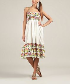 Show off sun-kissed shoulders with this fabulous frock! Breezy cotton pairs with a shirred bodice for a comfortable, flattering fit, while multi-colored birds sing a cheerful song throughout.
