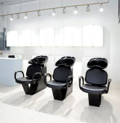 Lights above shampoo stations in hair salon