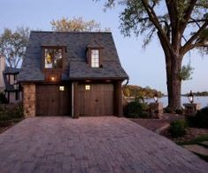mansard roof garage traditional with cottage bronze post lights