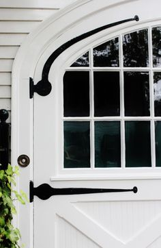 FARMHOUSE – vintage early american farmhouse showcases distinctive hardware like in this design by amy meier design with a marthas vineyard carriage door inspiration. Door Design, Exterior Design, House Design, Exterior Paint, Carriage Doors, Carriage House, White Cottage, Cottage Door, Cozy Cottage