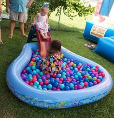 Ball pit game for 1st birthday party.  See more first boy birthday and party ideas at one-stop-party-ideas.com
