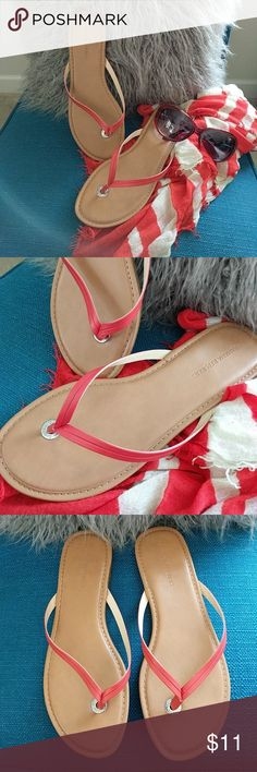 Banana Republic Vegan Leather Flip Flop Size 9.  These Banana Republic flip flops are super cute and comfy!  Tomato red/orange color.  Left sandal reflects a bit more wear on the heel.... otherwise great condition. Banana Republic Shoes Sandals