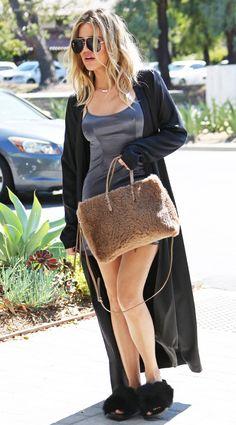Khloe Kardashian from The Big Picture: Today's Hot Pics  Warm and fuzzy! The reality star arrives at the studio in a silk dress and furry accessories.
