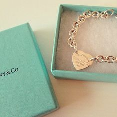 This is the dream bracelet...the heart in the chain not hanging off of it like a charm!!!! Dying for it