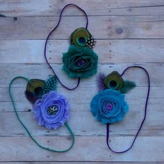 Shabby flower with Peacock feather. https://www.facebook.com/Mares-Lil-Boutique-563543313658309/
