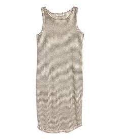 Sleeveless dress in linen jersey with a gently rounded hem.