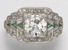 PLATINUM, DIAMOND AND SIMULATED EMERALD RING, CIRCA 1925