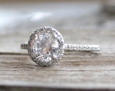 Round White Sapphire & Diamond Halo Engagement Ring in 14K White Gold by Studio1040 on Etsy https://www.etsy.com/listing/217745839/round-white-sapphire-diamond-halo