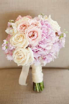 blush pink bridal bouquet includes hydrangea, spray roses, roses, and stock.  www.hautefloral.com