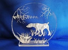 This is a hand carving of a Pointer with hiding Pheasants in tall grass. A great gift for any hunter!