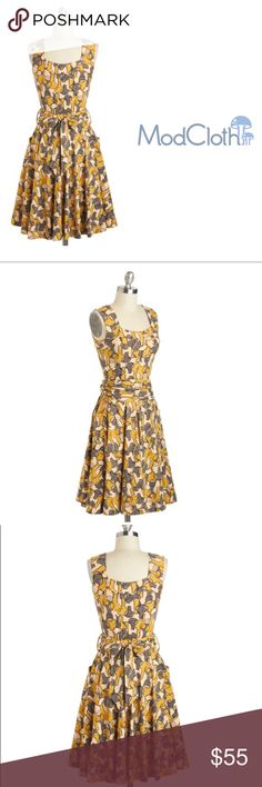 Effie's Heart Guest of Honor Dress in Vases Retro Style in soft but sturdy Prima cotton blend in ecru, stone and mustard. Wide Tie belt for flattering fit and dual hip pockets. Playful pattern of vases. Excellent condition. Modcloth Dresses