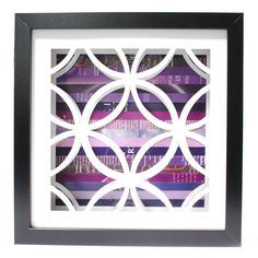 """Circles Shadowbox (by Amy Gibson) (2/2) - intricately hand-cut circles against a multi-hued collage of discarded pages. Shadowbox is 10"""" x 10"""", frame is 0.75"""" thick and 1.75"""" deep."""