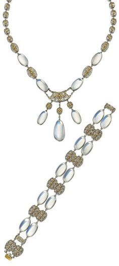 Arts and Crafts moonstone necklace and bracelet, attributed to Louis Comfort Tiffany, Tiffany & Co., circa 1915. The necklace, designed as a series of graduated filigree links, enhanced by oval moonstone cabochons, a bracelet, en suite of similar design, mounted in platinum and gold; necklace and bracelet signed Tiffany & Co. #LouisComfortTiffany #ArtsAndCrafts #necklace #bracelet