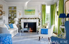 A green garland on the living room mantel works with the existing green colors.  - Photo: Gordon Beall / Design: Kelley Proxmire