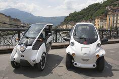 """70 Toyotas """"i-ROAD"""" e """"COMS"""", veículos ultra compactos elétricos, vão estar disponíveis num sistema de partilha de carros, promovendo a conetividade entre o transporte pessoal e transportes públicos, na cidade francesa de Grenoble."""
