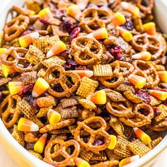 5-minute Pumpkin Spice Chex Mix With Chex, Wheat Chex, Mini Pretzel Twists, Honey Roasted Peanuts, Unsalted Butter, Light Brown Sugar, Corn Syrup, Pumpkin Pie Spice, Salt, Cranberries, Candy Corn