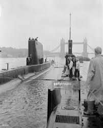 London, England July British Navy submarines HMS Trump & HMS Turpin pictured in the London Pool, Tower Bridge is in the background Get premium, high resolution news photos at Getty Images Royal Navy Submarine, Military Records, Royal Australian Navy, Naval History, War Image, Submarines, Press Photo, Tower Bridge, London England