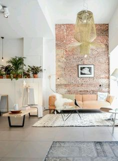 exposed brick wall, high ceilings, neutral palette