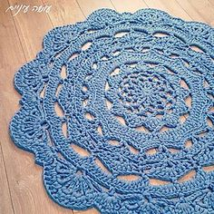 The Snorka crochet doily rug pattern is designed for crocheting with t-shirt yarn.