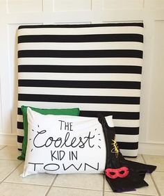 "Twin size black and white striped upholstered headboard || wall attachments included  How cute is this pillow cover from the one and only @target After this photo my 3 year old put on the cape and mask...I said, ""what a cute super hero"", her response, ""I'm A VILLAIN!""   #twinbed #headboard #twinheadboard #upolstery #upholsteredheadboard #bedroom #bedroomdesign #kidroom #kidsroom #decorforkids #target #boyroom #girlroom #bed #kiddecor #homedecor #etsyseller #lollyandjune"