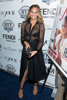 Chrissy Teigen opted for an appropriately sexy look for her cover story party showing just the right amount of skin in this black lace number. // #Fashion