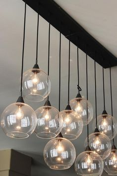 RJ & Francis' East/West Coast Loft House Tour from Apartment Therapy.  love these lights so much!