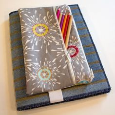 Stitch up a handy two pocket pencil pouch that attaches to any binder or sketchbook with this tutorial from WeAllSew.