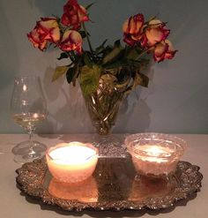#relax #sunday Sunday night relaxing. #wine #candlelight #metime #vintagesilvertray #silver  #crystal #preloved #roses #bellafiorefloraldesigns #pearlessencecandles #vintagelove #preloved #vintagesilver #silvertray
