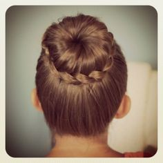 This is so easy! Make a bun,but leave a section of hair out, plait it,wrap it around the bun and finally bobby pin it in place! this should only take 45secs!