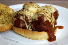 Smoked Meatball Sandwich   The meatball were smoked with a little hickory wood then place in a cast iron pan with the sauce. Topped with cheese and ready to serve.