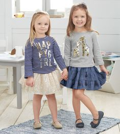 Grey Never Grow Up Tee - This solid gray cotton interlock long sleeve t-shirt features embroidered never grow up sentiment and gold and navy sequin giraffe appliques. Navy Happy Girl Tee - For the little sunshine in your life, this printed stripe cotton interlock long sleeve t-shirt features a gold and silver sequined HAPPY GIRL applique. Little Girl Skirts, Little Girl Outfits, Little Girl Fashion, Toddler Outfits, Kids Outfits, Kids Fashion, Little Girl Style, Full Skirt Outfit, Kindergarten Outfit