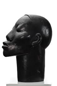 Dumile Feni's sculptures spotlight the difference between white and black in South Africa. Portraits displaying clear characteristics of native Africans remain untitled, and therefore given that name: Untitled. They are depicted as the archetype of t African Masks, African Men, South African Artists, Male Figure, Archetypes, Sculptures, Racing, Statue, History