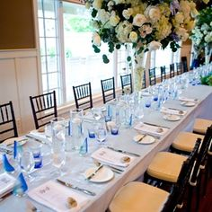 @Victoria Clausen Florals  Light blue linens and sailboat candle favors reflected Sara and Dave's charming nautical theme.