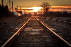 Tracks by Dan Fearing on Capture Wisconsin // Railroad tracks lead to the rising sun on the back side of Reedsburg's industrial Park