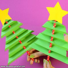 little accordion paper Christmas tree craft for kids has to be the cutest little holiday project to make with your kids ever.This little accordion paper Christmas tree craft for kids has to be the cutest little holiday project to make with your kids ever. Christmas Tree Crafts, Preschool Christmas, Christmas Christmas, Christmas Crafts For Kids To Make At School, Christmas Projects For Kids, Childrens Christmas Crafts, Holiday Activities For Kids, Christmas Decorations For Kids, Preschool Age