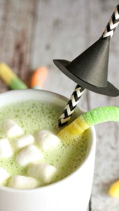 Halloween Hot Cocoa Recipe ~ warm and delicious... Plus a link to the tutorial to make the Witch Hat Straws
