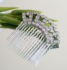 """This lovely handmade wedding Tiara has been added to a hair comb and is perfect for your big day.  The rhinestones were a vintage 1950's shoe clip that I took apart and added it to a comb.     * 2 inches high at the tallest point,including the comb  * 2.25 inches across   * Weighs less than 1 oz  * The rhinestones are bright.  * The Silver metal comb is lead free  * I will send USPS Priority Mail in the USA.     """"The perfect way to wear something old and something new""""    See my other hair…"""