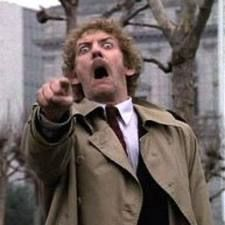 Invasion of the Body Snatchers - scary and a great love story. I think this remake is better than the original.