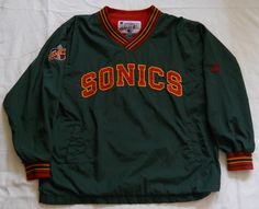Vintage late 90s Seattle Supersonics pullover jacket by Champion. Men's XL [faded name written on the neck tag]. (pre-owned)