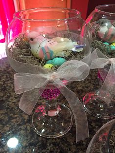 Bird nest center pieces.. Glued small fish bowl to candle stick.